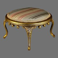 Antique Upholstered Round Foot Stool with Curved Metal Legs