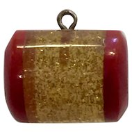 Red Bakelite Laminated Stardust Applejuice Gold Glitter Barrel Shaped Button