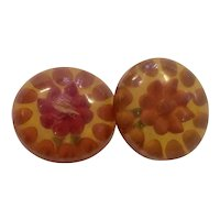 Two (2) Related Reverse carved and Painted Apple Juice Geometric domed small Bakelite Buttons