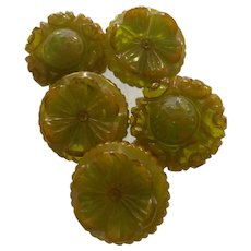 Five (5) Heavy Carved Translucent Apple Green Bakelite Buttons