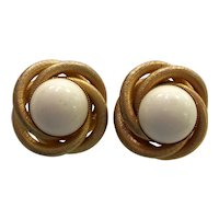 KJL Goldtone Swirl Mount with White Domed Cabochon Clip Earrings
