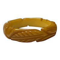 1930s Art Deco Carved Butterscotch Bakelite Bangle with Stylized Leaf Carved Detail