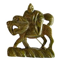 1930s Faux Jade Bakelite Chinoiserie Warrior on Horseback Ornately Carved Figural Pin