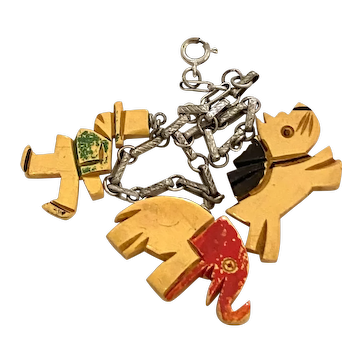 Adorable 1930s Cream Bakelite Carved and Painted Figural Charm Bracelet