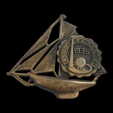 1930s NY Worlds Fair Trylon Perisphere on Sailing Ship Brass Pin Brooch