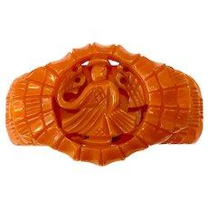 Rare and Exotic 1930s Orange Carved Bakelite Asian Deity Hinged Bracelet Orientalia
