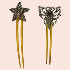 A pair of Victorian Cut Steel Butterfly and Star Horn Combs