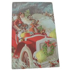 Old Edwardian Christmas Postcard with Santa in Car with Dolls and Toys c1915