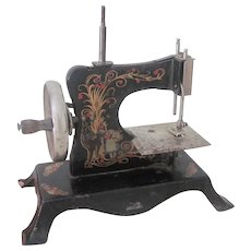 Old German Child's Toy Metal Sewing Machine with Lithographs c1900