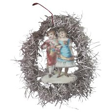 Old Victorian Die Cut and tinsel Christmas Ornament Decoration