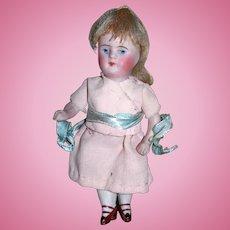 "4 1/2"" Antique All bisque doll original wig"