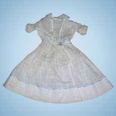 Sweet Antique dress Window Pane material with blue embroidery.