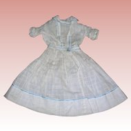 Sweet Lady dress Window Pane material with blue embroidery.