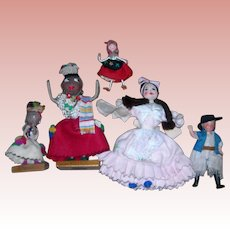 5 South American dolls; 4 cloth and one Composition