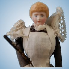 Doll House Maid with Vacuum is the shoulder head.er hair is molded and