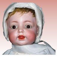 "17"" #122 Simon-Halbig Character Baby Wobble Tongue dressed to the Nines!"
