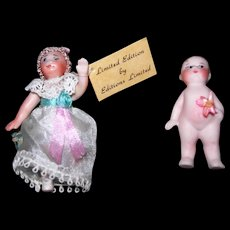 Two tiny Porcelain Doll House dolls