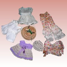 8 Pieces of small doll clothing; all bisque dolls