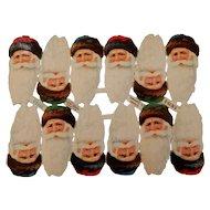 Embossed German Die Cut Santas
