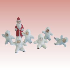 Six Snow Babies and Santa
