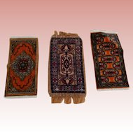 Three Miniature Oriental Tobacco Rugs
