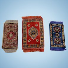 Three Miniature Oriental Tobacco Rugs