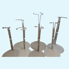 7 Assorted Heavy Kaiser Doll Stands