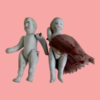 Two Tiny  German Jointed Stone Bisque Dolls