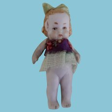 Tiny All Bisque Doll with Molded Bow