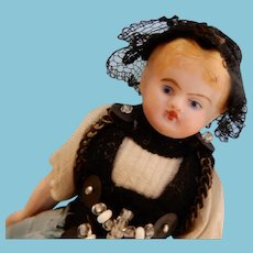 Small  Bisque Doll in Original Clothing