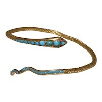 Enchanting Antique Victorian 22K Yellow Gold Sleeping Beauty Blue Turquoise and Ruby Eyes Snake Bangle Bracelet