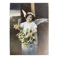Christmas Angel Holding Tree Postcard