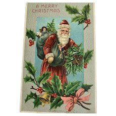 A Merry Christmas Santa Postcard Toys on Back Holly Made In Germany