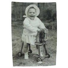 Toddler On Push Along Toy Horse Photo Photograph
