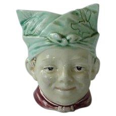 Majolica Bank Boy With Figural Head Scarf