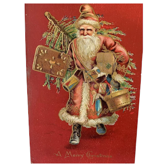 Embossed Christmas Postcard Santa With Tree On Back And Carrying Toys