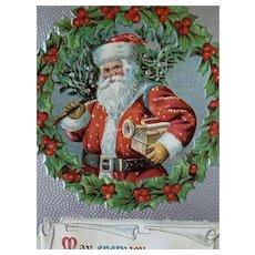 Incised Santa Holding Horn Christmas Postcard