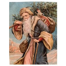 Santa In Blue Robe Embossed Postcard With Toys And Tree On His Back