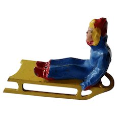Barclay Manoil Lead Figurine Man Sitting On Sled