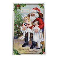 Girl Sitting On Santa Lap Embossed Christmas Postcard Holding Doll