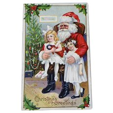 Girl Sitting On Santa Lap Embossed Christmas Postcard Holding Doll
