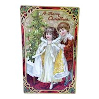 Boy Helping Girl With Cloak Christmas Postcard Tuck's