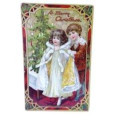 Boy Helping Girl With Cloak Christmas Postcard Tuck's