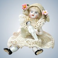 Antique  4 inch All Bisque Doll with Wardrobe