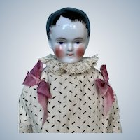 "Antique China Doll Representing Child with ""Kinderkopf"" Hairstyle"