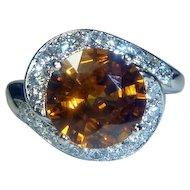 Brilliant 4.35 Ct. Orange Sapphire, Platinum & Diamond Art Deco Ring