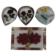 Four Lucite Pins With Decorations