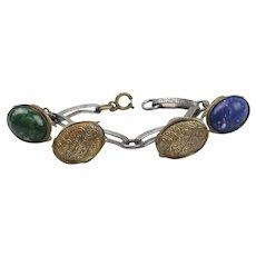 4 Vintage Pocket Watch Fobs On Bracelet