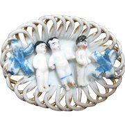 3 Miniature Frozen Charlottes In Porcelain Basket