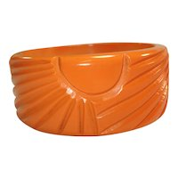 Wide Sunburst Carved Cantaloupe Bakelite Bangle Bracelet